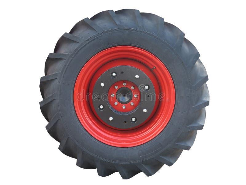 Roda vermelha do pneu do trator isolada sobre o branco fotografia de stock royalty free