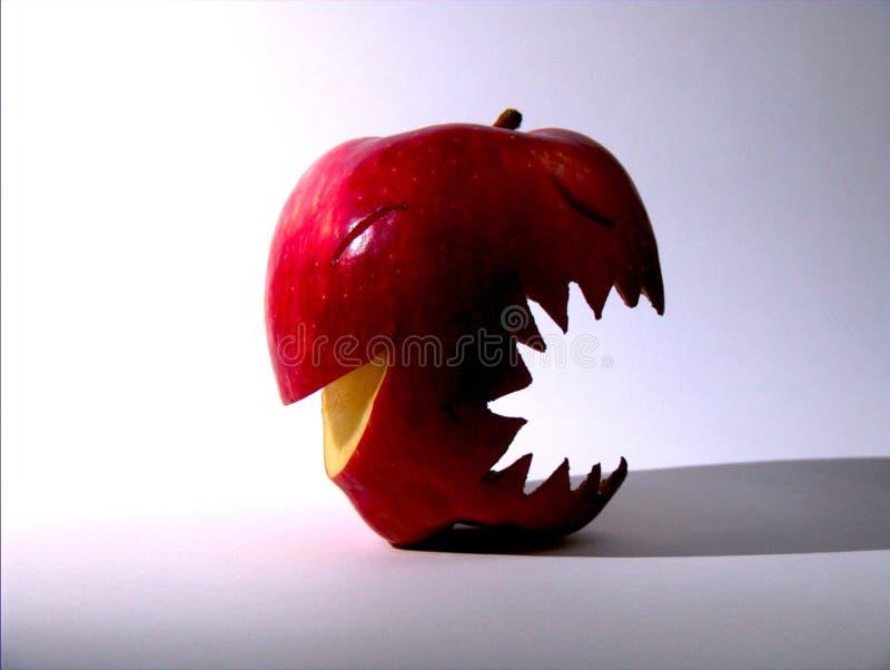 rode appel met gelukkig & boos gezicht royalty-vrije stock afbeeldingen