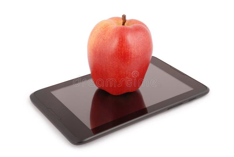 Rode appel op een het Knippen van tabletpc weg royalty-vrije stock foto