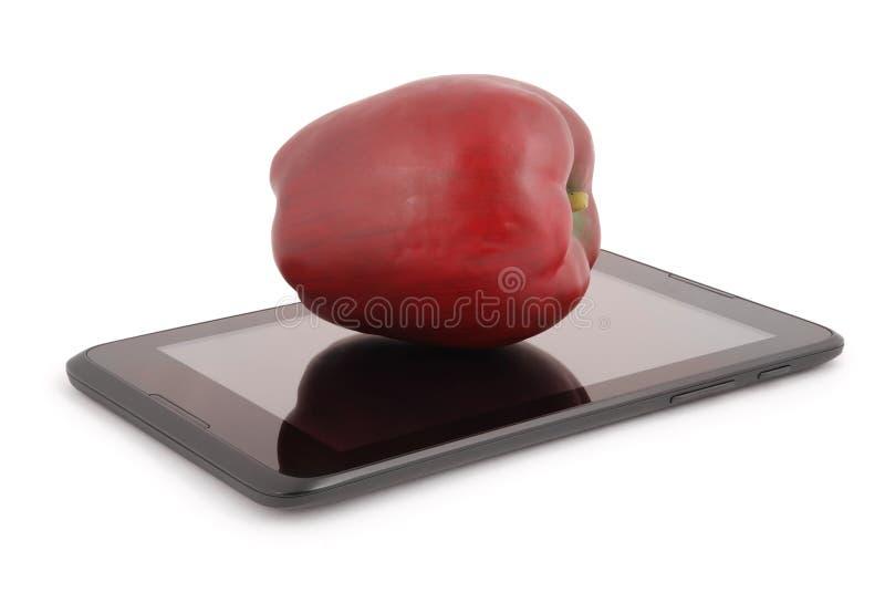 Rode appel op een het Knippen van tabletpc weg royalty-vrije stock fotografie