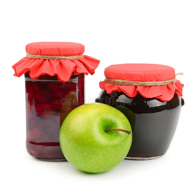 Rode appel op kruik jam royalty-vrije stock foto