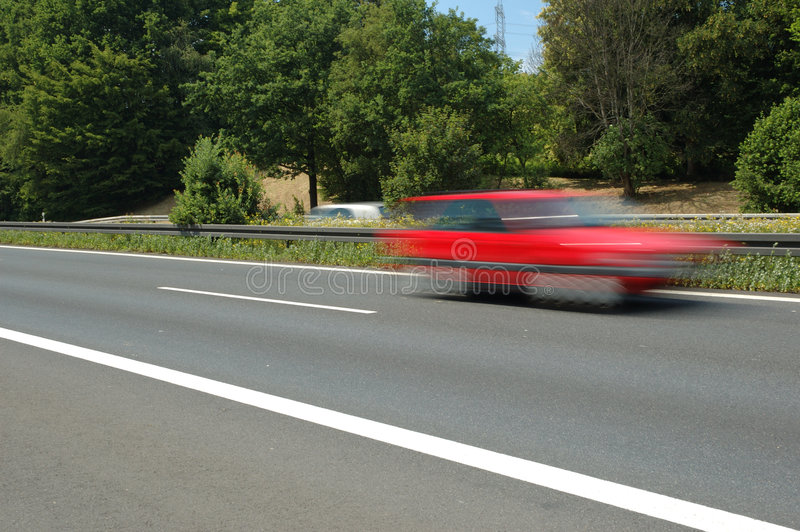 Rode auto royalty-vrije stock afbeelding