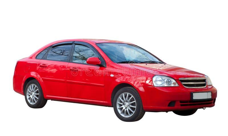 Rode auto op wit. Geïsoleerd over wit royalty-vrije stock fotografie