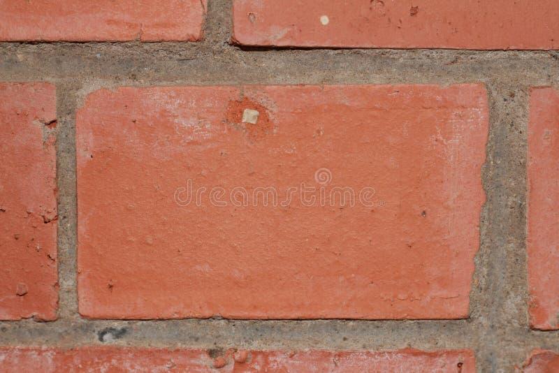 Rode baksteen en cementtextuur als deel van een close-up van het muurkader stock afbeeldingen