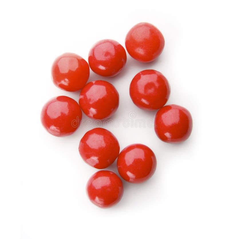 Rode ballen op wit stock fotografie