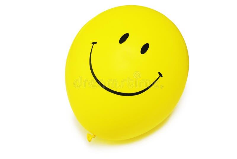 Rode baloon - glimlach die op wit wordt geïsoleerdl stock afbeeldingen