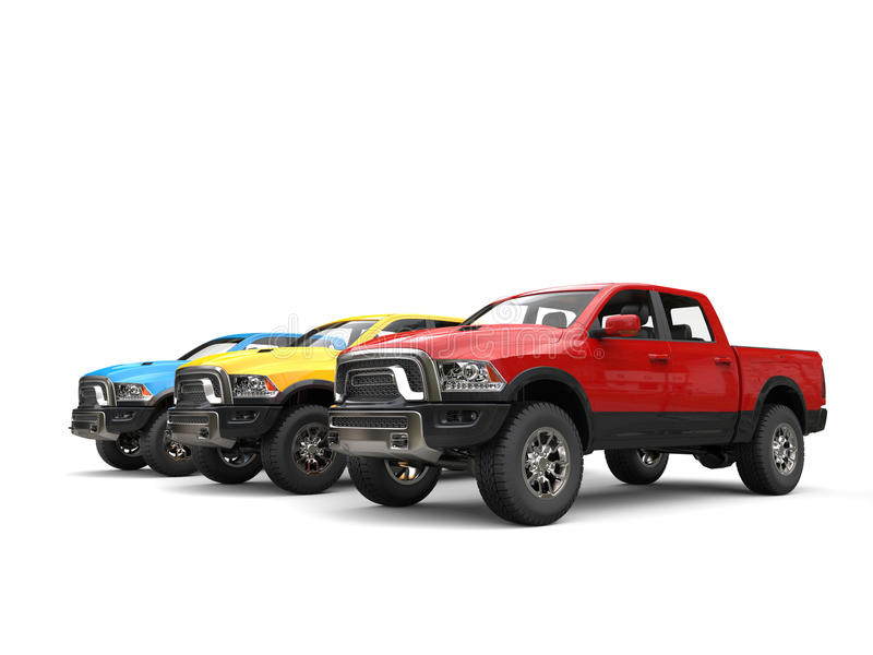 Rode, blauwe en gele moderne oogstvrachtwagens - schoonheidsschot stock afbeeldingen