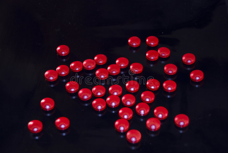 Rode cafeïnePillen stock fotografie