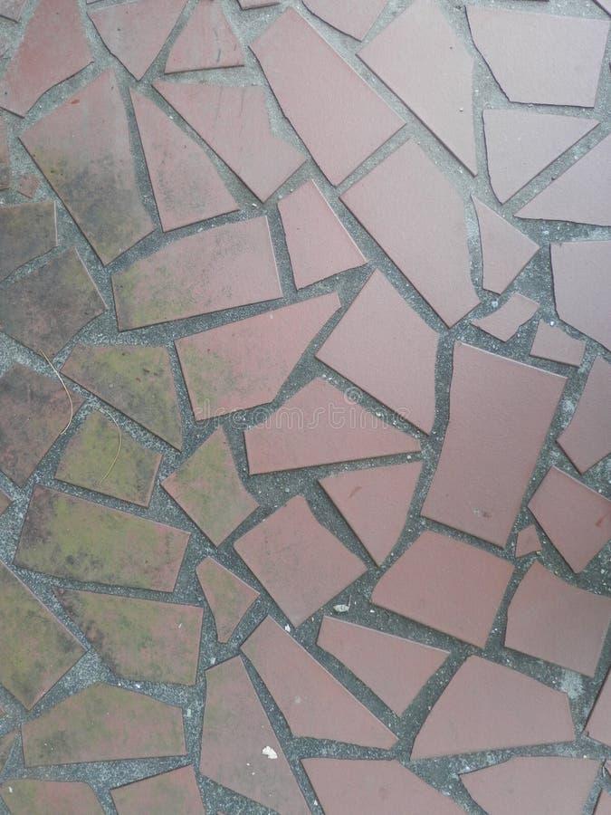 Rode de gangachtergrond van de terracottategel stock foto