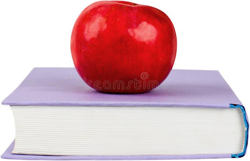 Rode die appel op het boek op achtergrond wordt geïsoleerd royalty-vrije stock foto