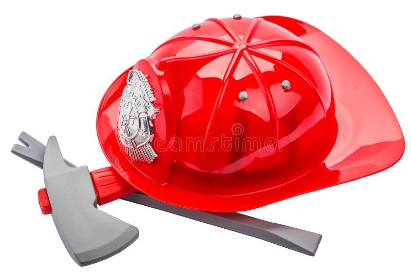 Rode die brandweermanhelm, op witte achtergrond wordt geïsoleerd stock fotografie