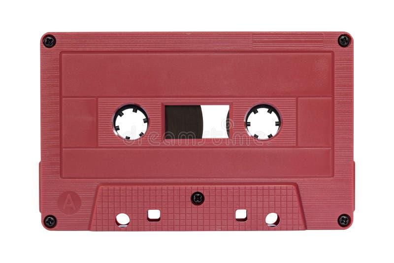 Rode die cassetteband op wit wordt geïsoleerd royalty-vrije stock afbeeldingen