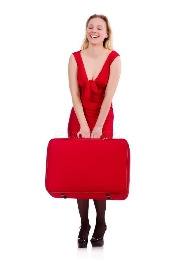 Rode die de holdingsboomstam van de kledingsvrouw op wit wordt geïsoleerd royalty-vrije stock foto's