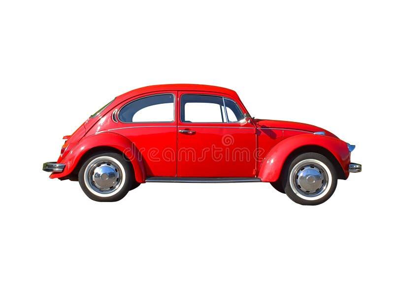 Rode die Keverauto op zwarte achtergrond wordt ge?soleerd stock foto's
