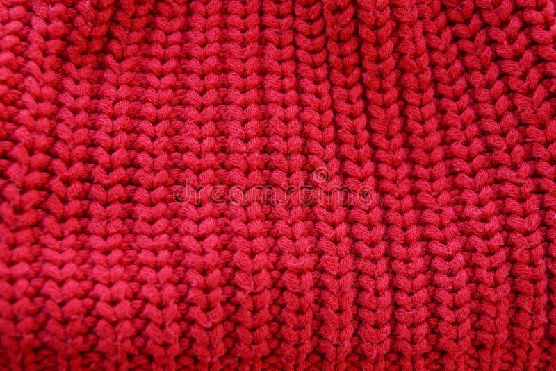 Rode die textuur van wolstof op kleren van sweaters wordt gemaakt stock afbeeldingen