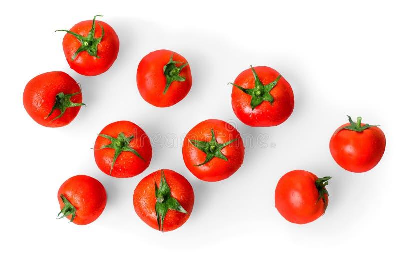 Rode die tomaten op een witte achtergrond worden geïsoleerd stock afbeeldingen