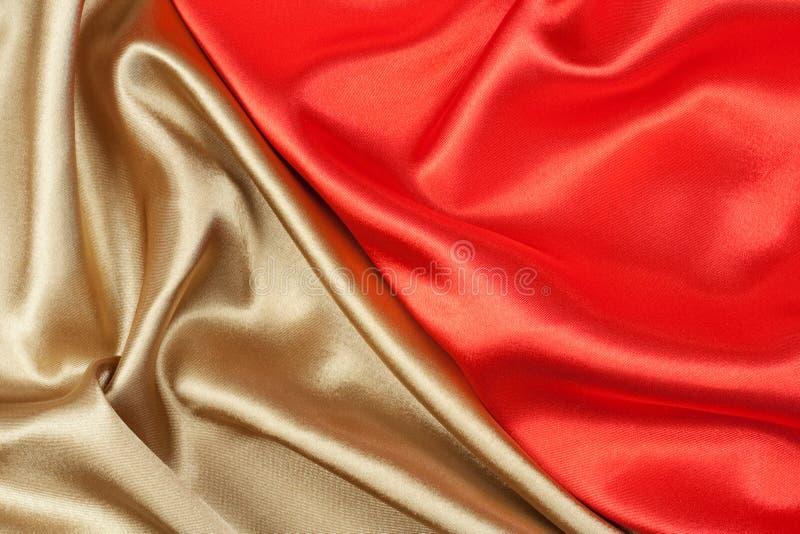 Rode en gouden zijde royalty-vrije stock foto's