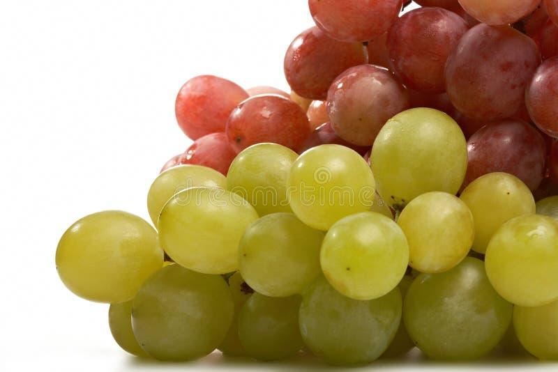 Rode en groene druivenclose-up stock foto