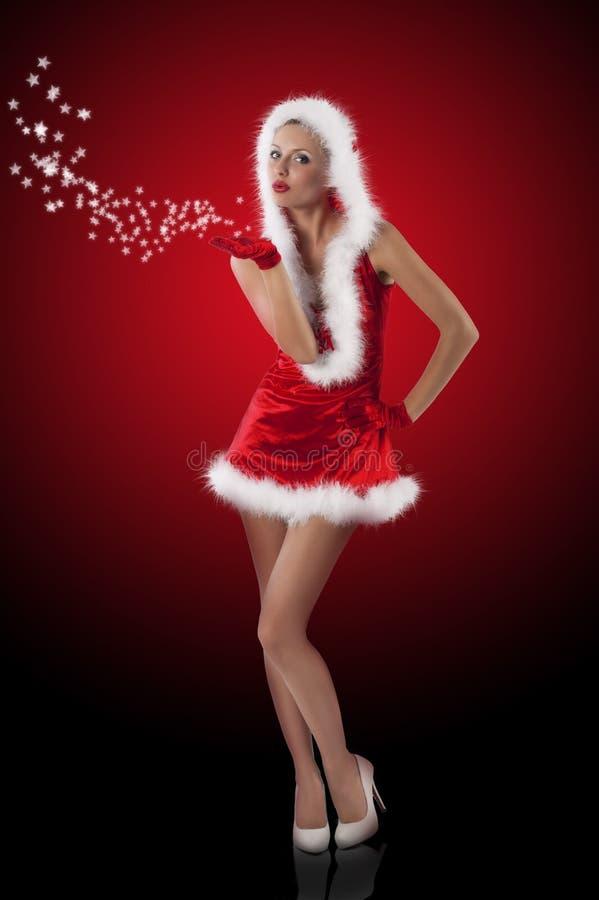 Rode en sexy het meisjes blazende giften van de Kerstman royalty-vrije stock afbeeldingen