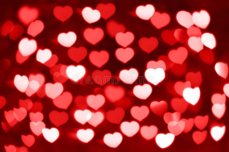Rode en witte harten bokeh als achtergrond royalty-vrije stock afbeeldingen