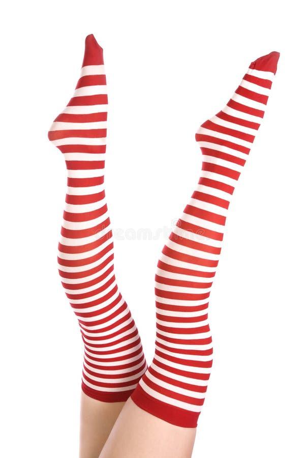 Rode en witte sokken op benen royalty-vrije stock foto