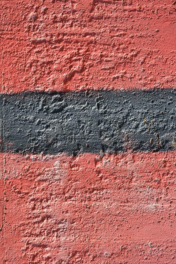 Rode en zwarte verf op de muur Een deel van de graffiti grunge De achtergrond van de textuur stock afbeeldingen