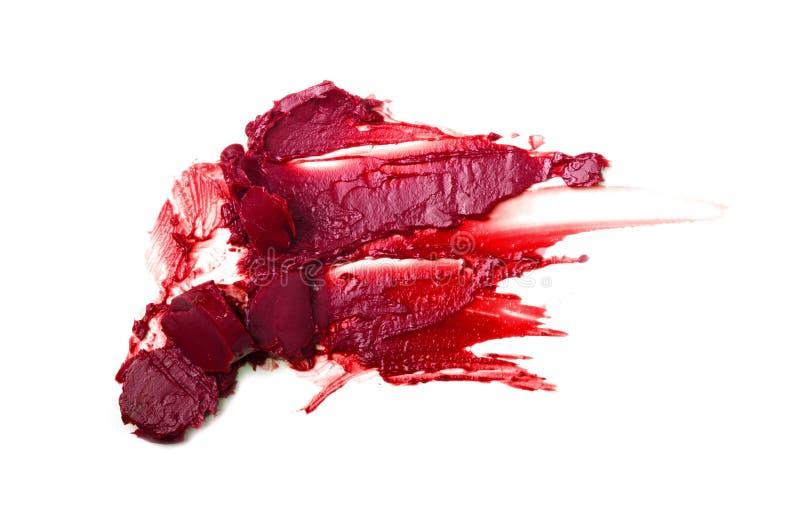 Rode geïsoleerde lippenstiftvlekken royalty-vrije stock afbeelding
