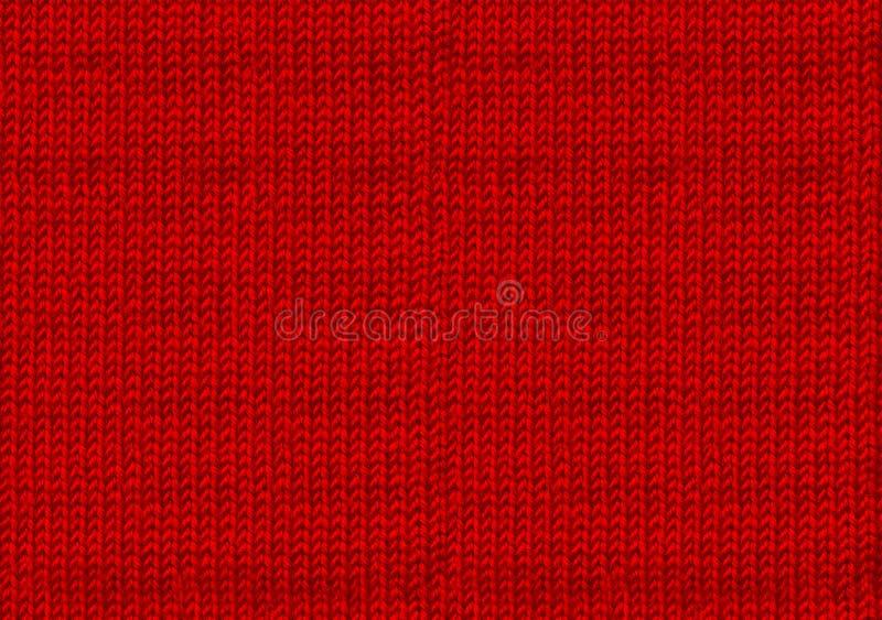 Rode gebreide houten kerstachtergrond De atmosfeer van een warme sweater Achtergrond nieuw jaar Textuur van de wol of van het acr stock afbeeldingen
