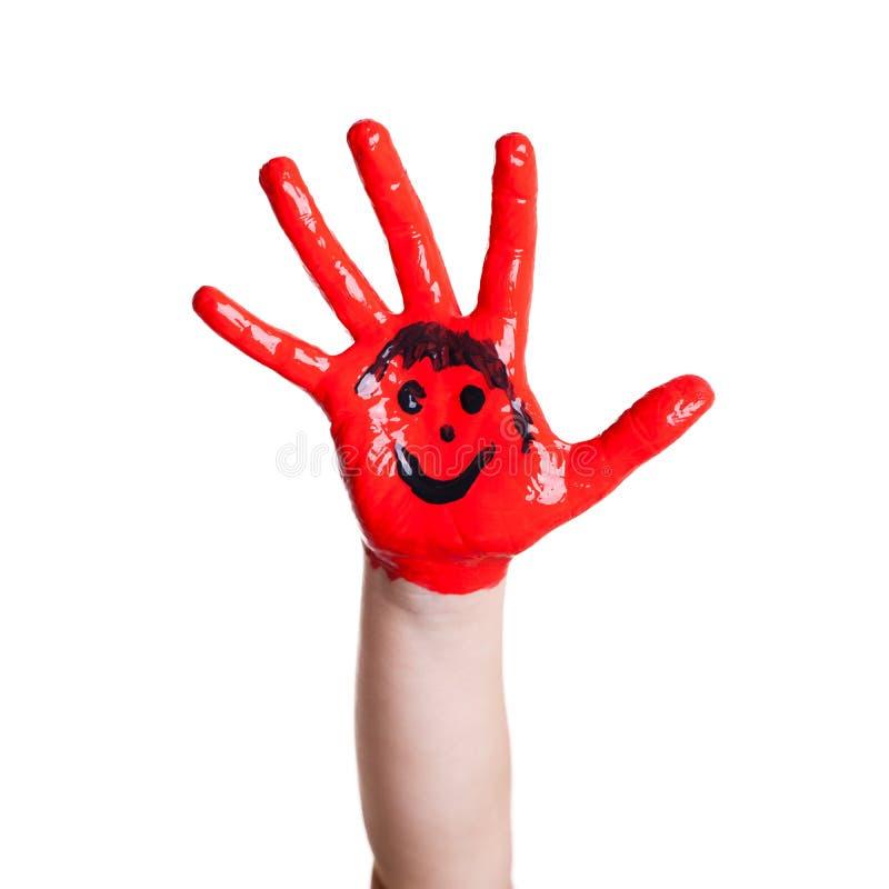 Rode geschilderde hand met een smiley stock fotografie