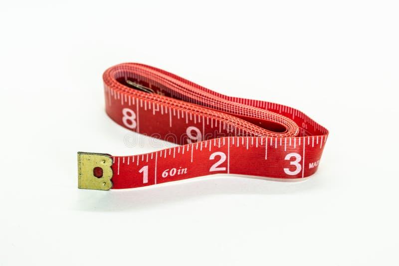 Rode gevouwen metende band royalty-vrije stock afbeeldingen