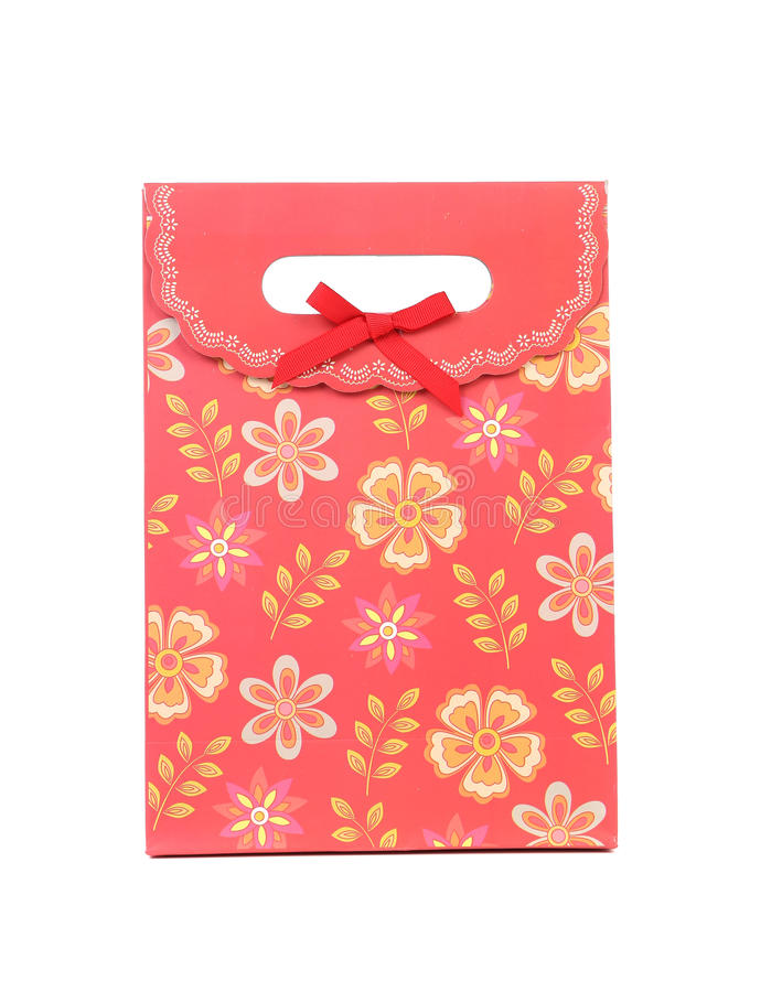 Rode giftdocument zak met bloemen ptint. royalty-vrije stock afbeeldingen