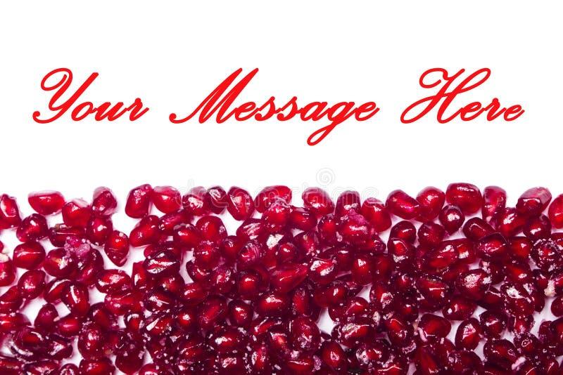 Rode glanzende granaatappelzaden royalty-vrije stock fotografie