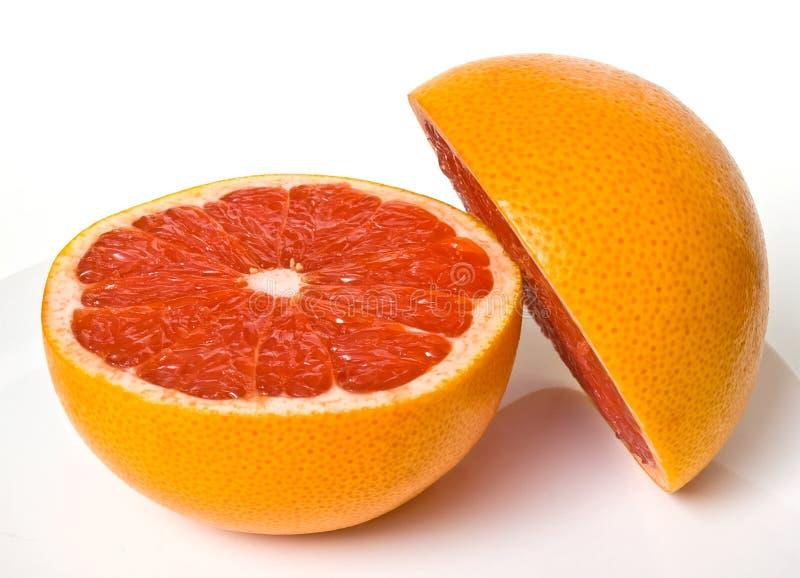Rode grapefruitstukken royalty-vrije stock foto's