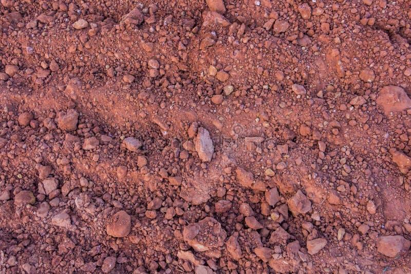 Rode grondtextuur stock afbeeldingen