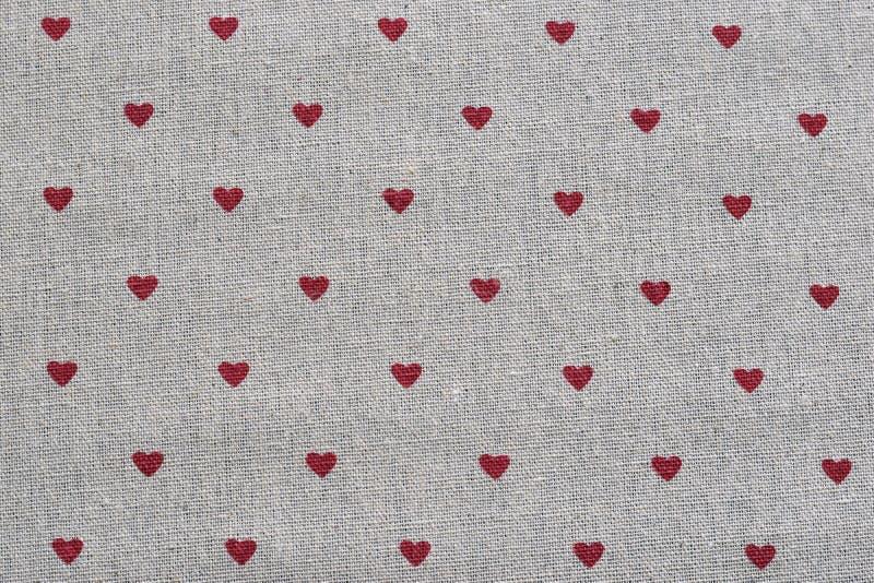 Rode harten over de achtergrond van de linnentextuur royalty-vrije stock foto's