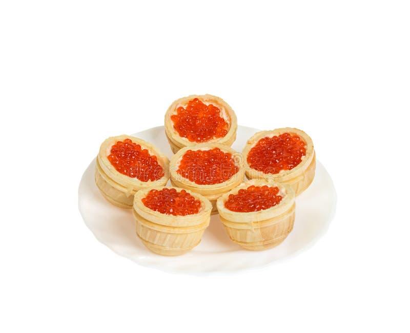 Rode kaviaar in tartlets. Geïsoleerd royalty-vrije stock foto
