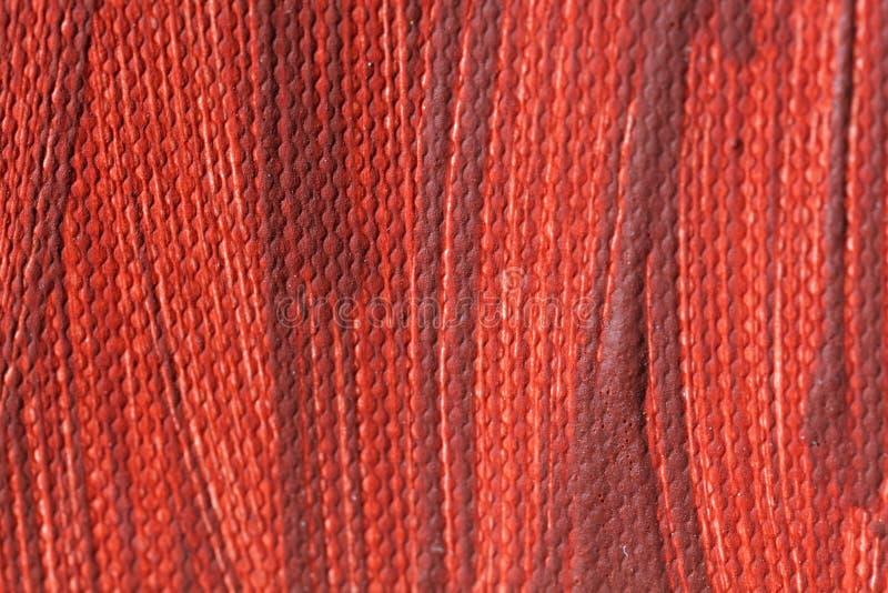 Rode kleur van het schilderen op canvas stock afbeelding