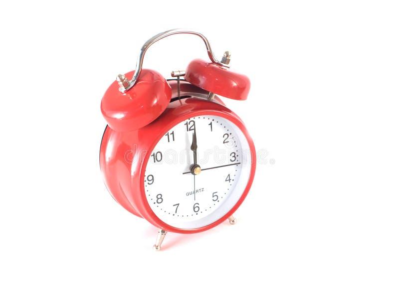 Rode klok bij middernacht/middag stock foto