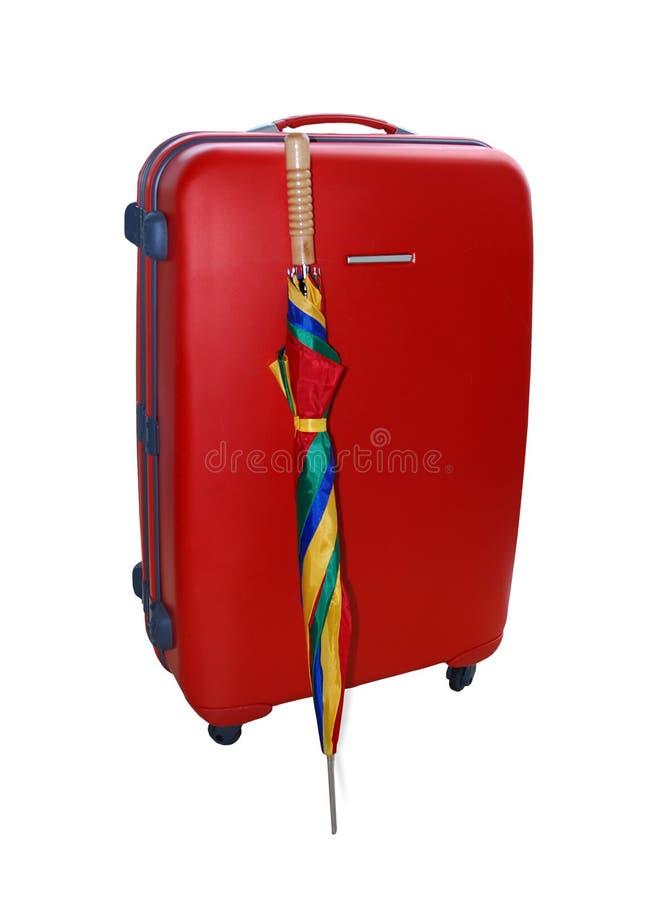 Rode Koffer en Paraplu stock foto's
