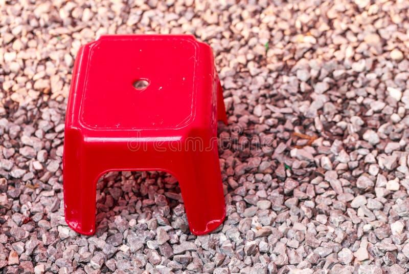 Rode kruk in weinig steenvloer royalty-vrije stock afbeelding