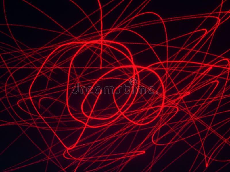 Rode lijnen op een zwarte achtergrond stock afbeeldingen