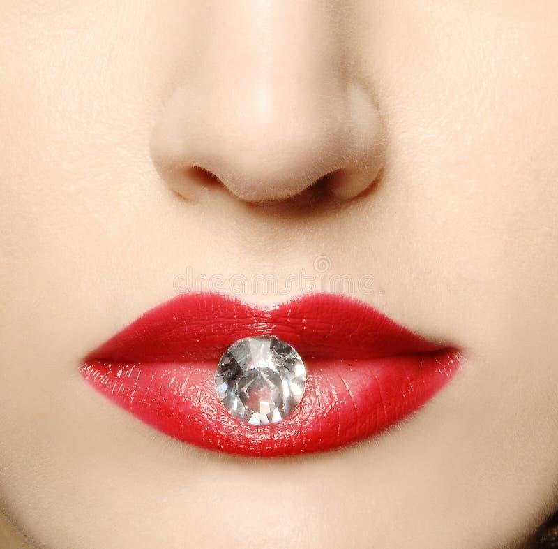Rode lippen en diamant royalty-vrije stock foto