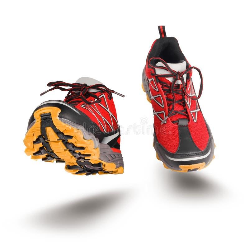 Rode lopende sportschoenen royalty-vrije stock afbeeldingen