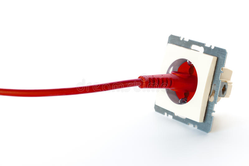 Rode machtskabel die in muurafzet wordt gestopt royalty-vrije stock fotografie