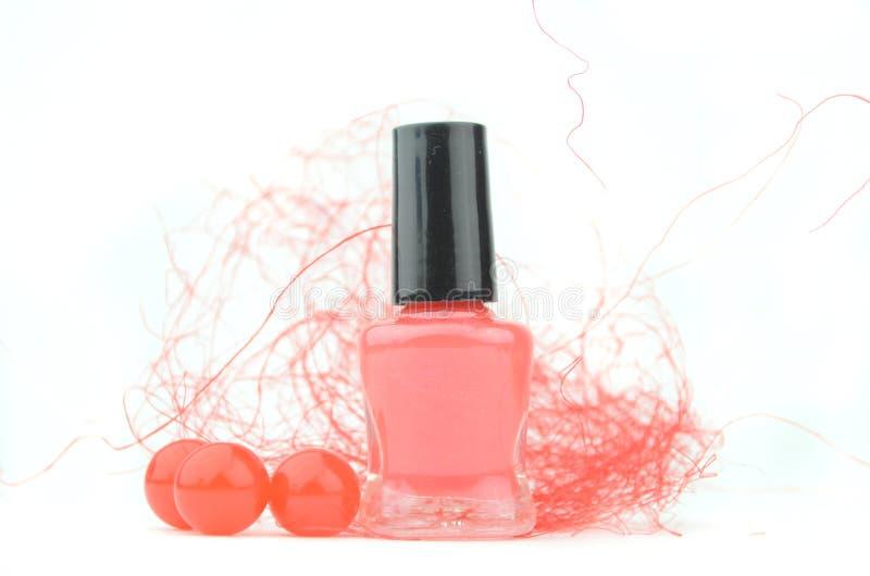 Rode nagellakfles royalty-vrije stock afbeeldingen