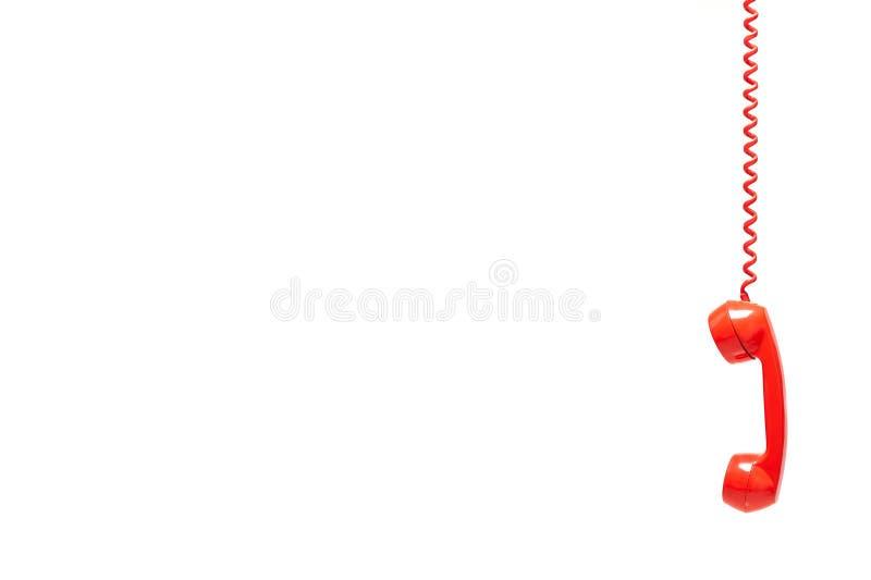 Rode oude die telefoonontvanger op witte achtergrond wordt geïsoleerd stock afbeeldingen