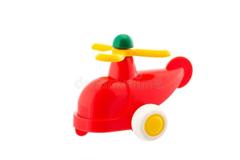 Rode plastic die helikopter, babystuk speelgoed op wit wordt geïsoleerd royalty-vrije stock foto