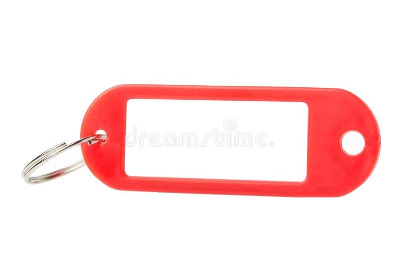 Rode plastic zeer belangrijke markering of etiket dichte omhooggaand geïsoleerd op witte achtergrond royalty-vrije stock fotografie
