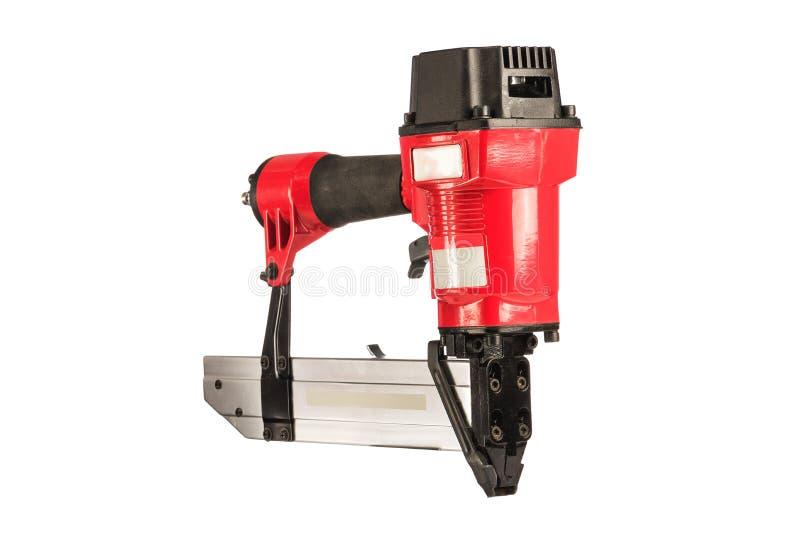 Rode pneumatische nietmachine op een witte achtergrond Geïsoleerde royalty-vrije stock foto's