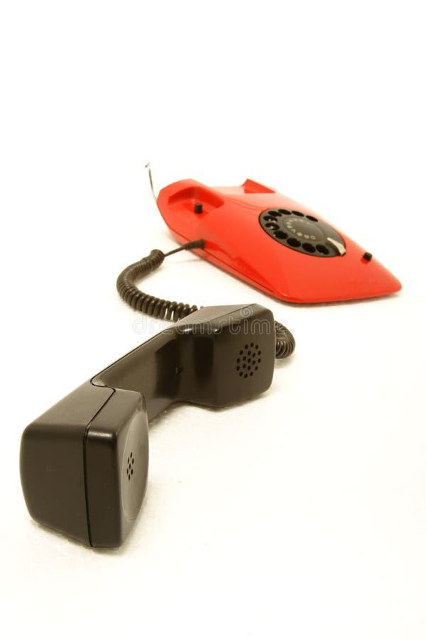 Rode retro telefoon royalty-vrije stock afbeelding